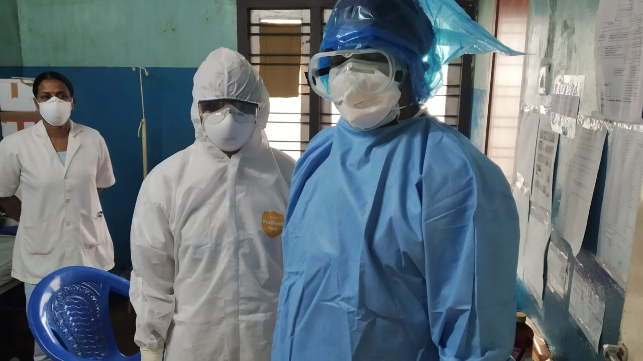 Healthcare workers wearing personal protective equipment while caring for patients with coronavirus infection in the Indian state of Kerala.