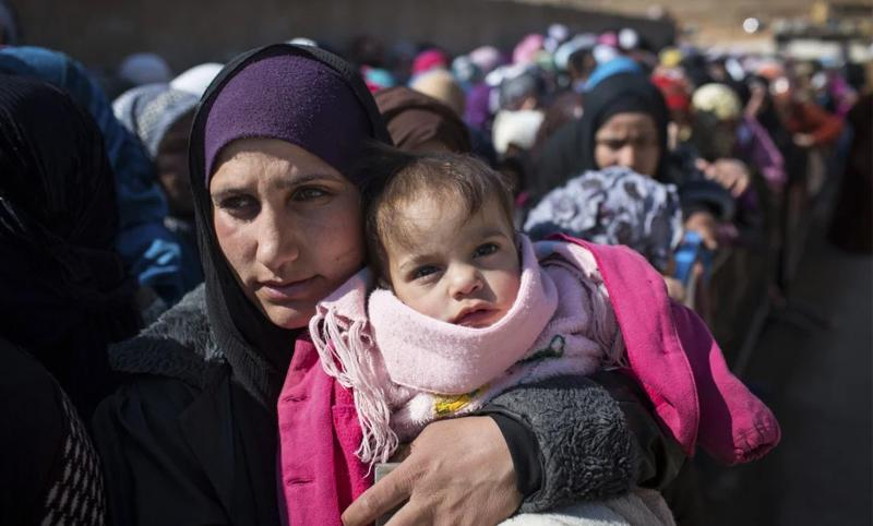 Syrian refugee women and children